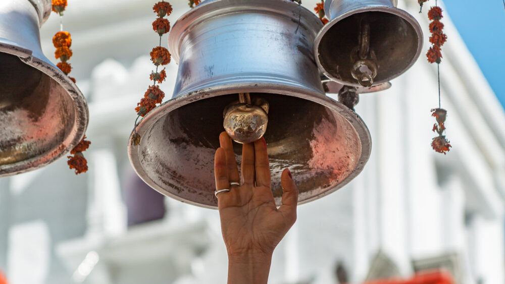 Temple Bell rang by women hand